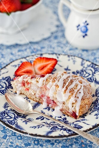 Strawberry scones on a plate with fresh berries