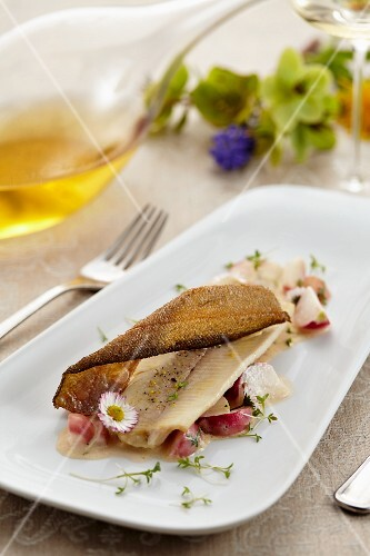 Poached trout fillet on braised radishes and cress