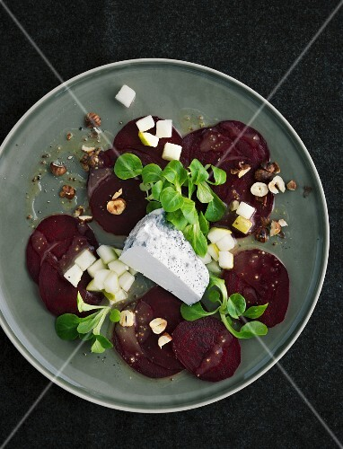 Beetroot carpaccio with Valencay on a grey plate