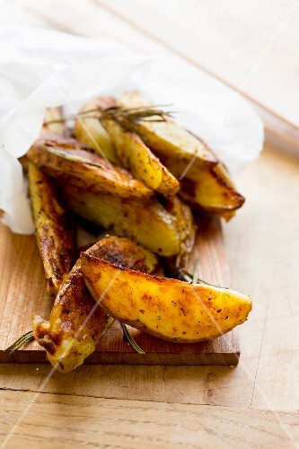 Roasted potato wedges in paper