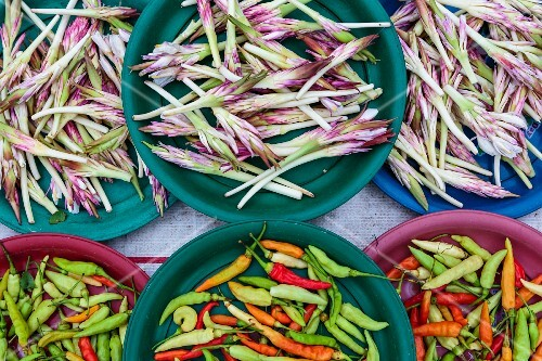 Fresh chilli peppers and edible flowers at a market (Vientiane, Laos)