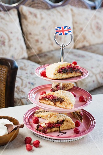 Raspberry and chocolate scones on a cake stand