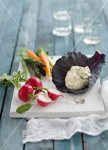 Feta cream in a cabbage leaf with vegetables