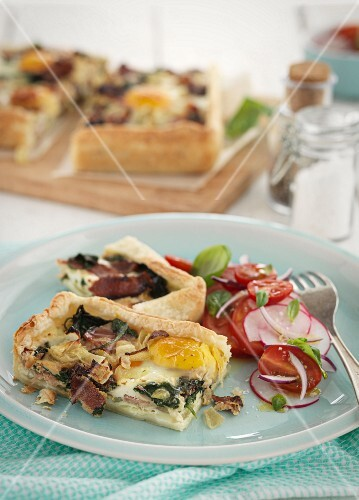 Puff pastry slices with bacon and fried egg