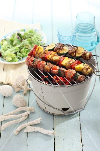 Shish kebabs on a table barbecue with salad