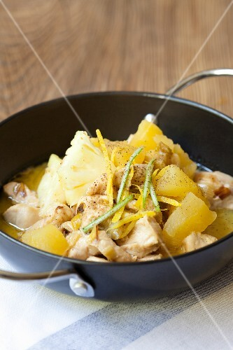 Chicken in coconut milk with lemons, apples and pineapple