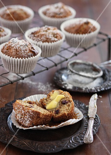 Bran muffins with cranberries and butter