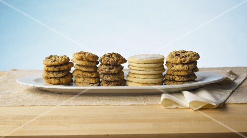 Stacks of various cookies on a serving platter