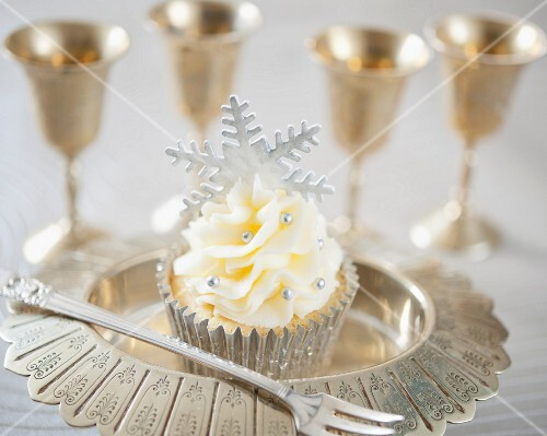 A festive Christmas cupcake with silver fondant snowflake