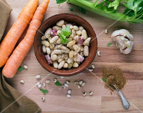 Ingredients for bean soup with bacon, celery, carrots, garlic and spices