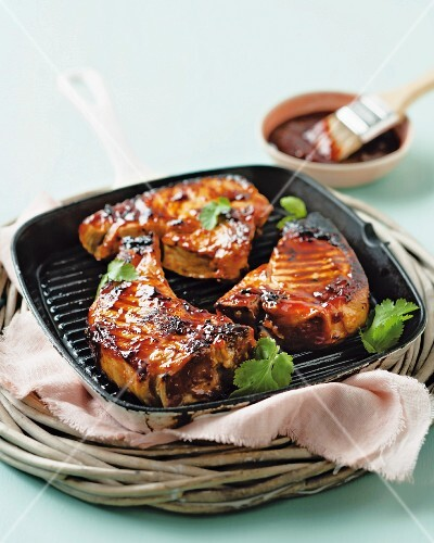 Pork chops with cranberry-barbecue sauce in a griddle pan