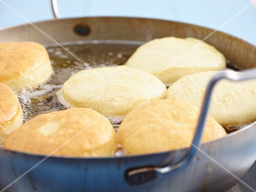Doughnuts being fried