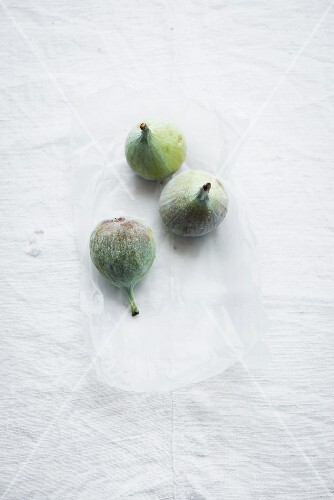 Figs on a white surface