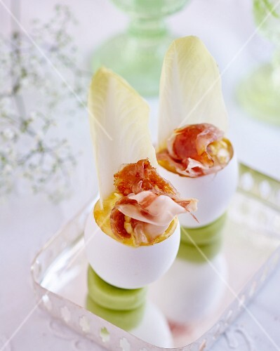 Eggs with chicory, Parmesan cheese and Parma ham