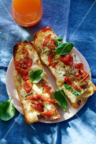 Pizza baguette with tomatoes and mozzarella