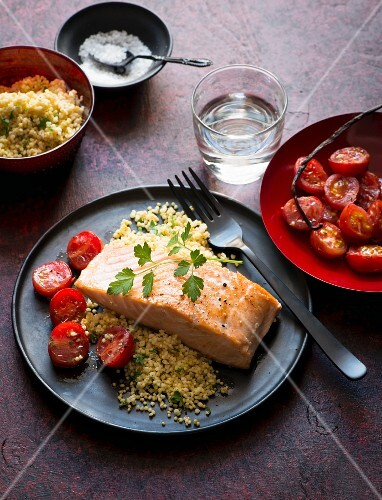 Salmon fillet with tomatoes and couscous