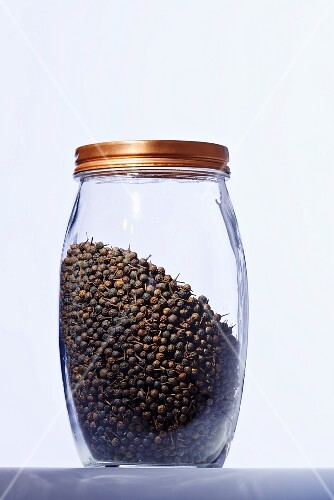A jar of black peppercorns