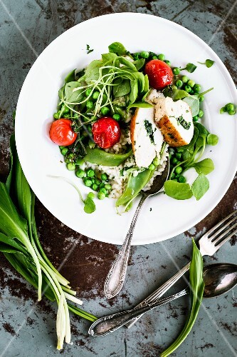 Wild garlic risotto with stuffed chicken breast and peas