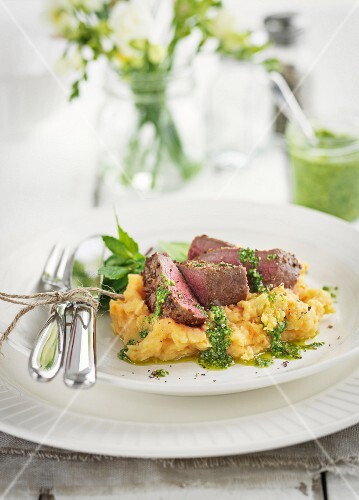 Lamb steak with mashed potatoes and mint sauce