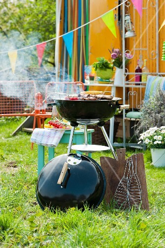 Food on a barbecue in a summer garden