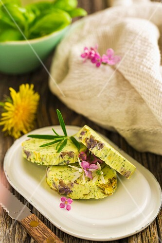 Blossom and herb butter with lilac flowers and dandelion flowers