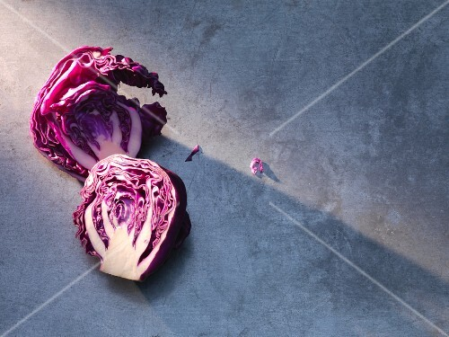 Sliced red cabbage on a grey surface (seen from above)