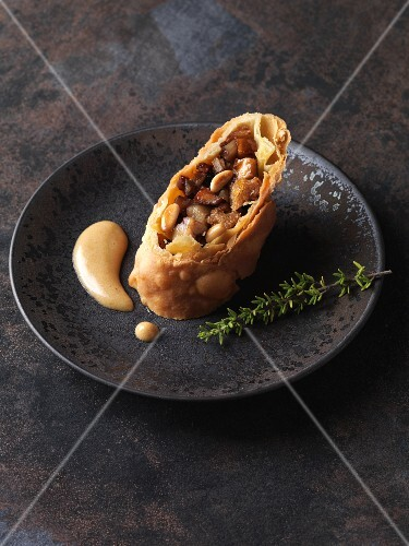Hearty chestnut strudel with dark beer sabayon