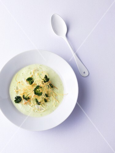 Green parsley root soup with fried parsley root spaghetti