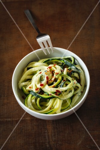 Vegetable spaghetti made from courgette with avocado sauce