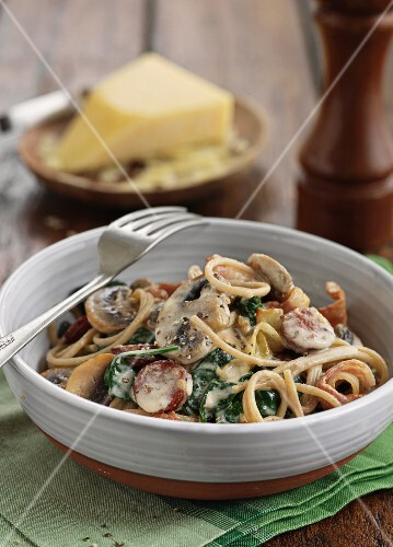 Spaghetti carbonna with sausage, mushrooms and spinach