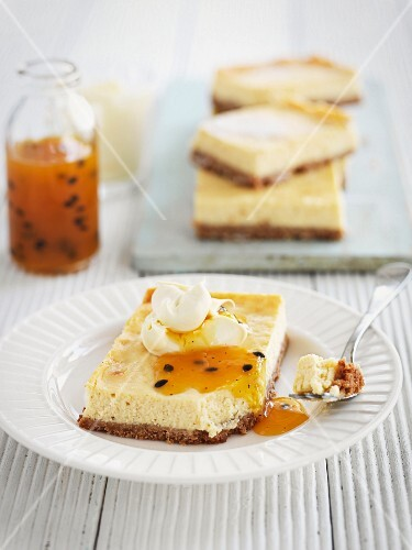 Slices of cheesecake with passion fruit sauce
