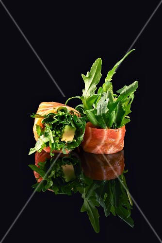 Two salmon rolls with avocado and rocket