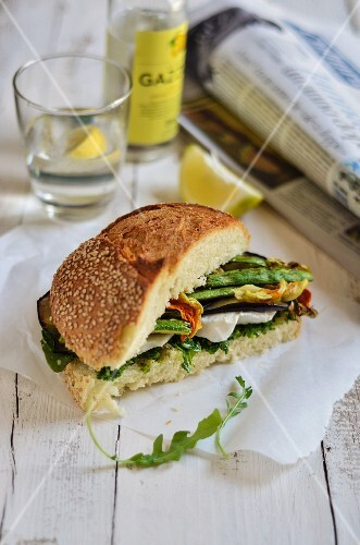 A vegetarian sandwich with grilled vegetables, mozzarella and courgette flowers
