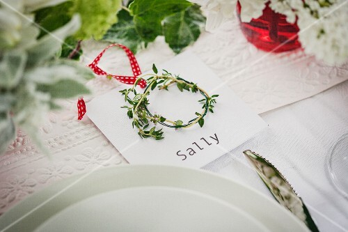Place setting with name card and little wreath of herbs