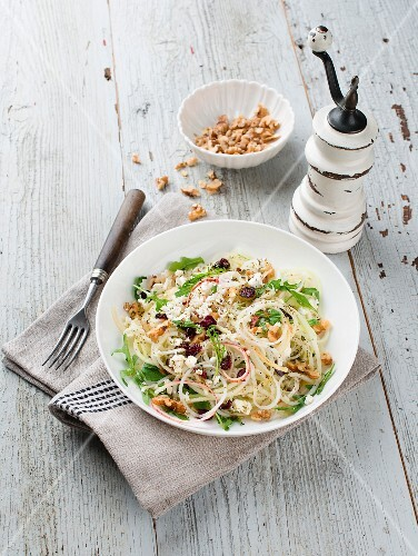 Kohlrabi and apple salad with goat's cheese, walnuts and cranberries