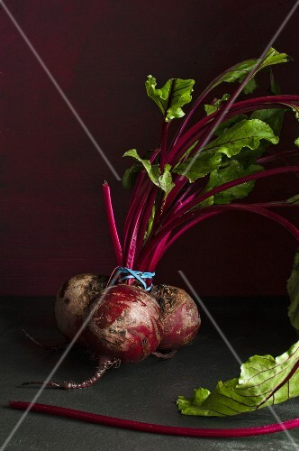 A bunch of beetroots on a dark surface