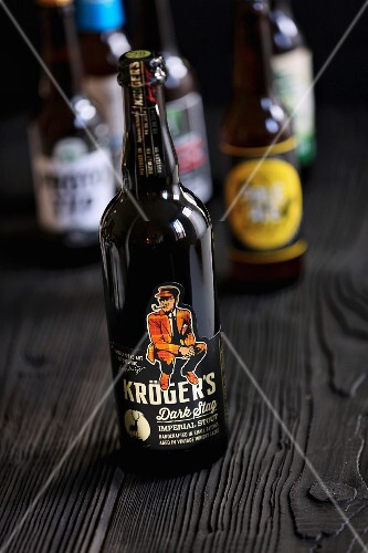 A bottle of Kröger's Dark Stag Imperial Stout (craft beer from an artisan brewery)