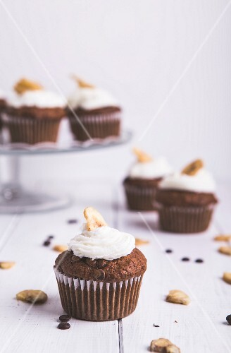 Cupcakes with banana frosting and banana chips