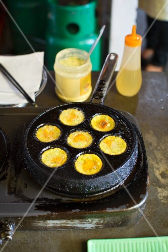 Mini eggs being fried in a pan (Vietnam)