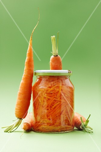 Fresh carrots and a glass of carrot salad