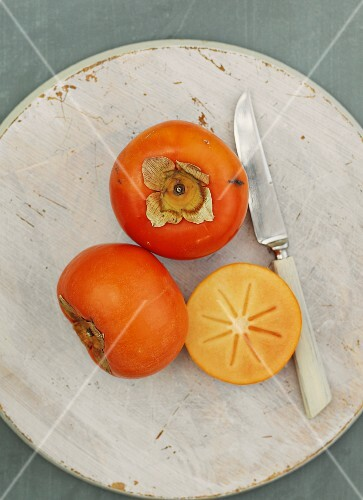 Persimions, whole and halved