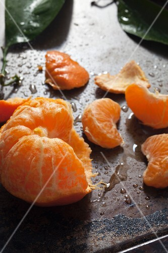 A peeled clementine peel and leaves