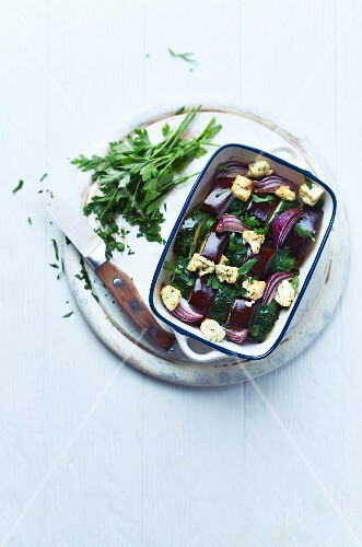 Oven-baked aubergines and courgettes with goat's cheese and red onions