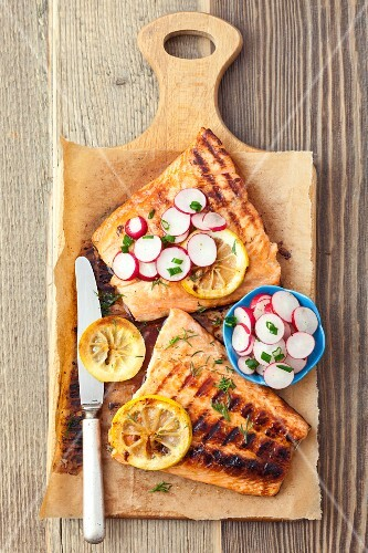 Grilled salmon with a honey and soy sauce glaze with radishes, spring onions and dill