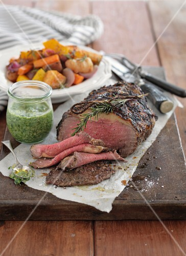 Roast beef with herb sauce and oven-roasted vegetables