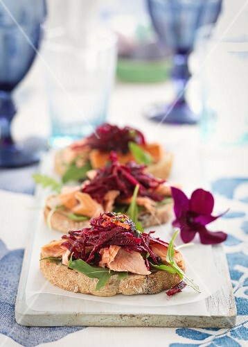 Crostini topped with salmon and beetroot salad