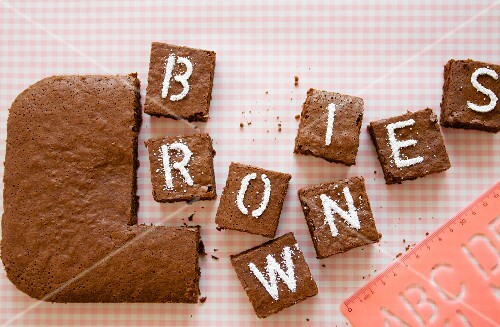 Cardamom brownies decorated with letters