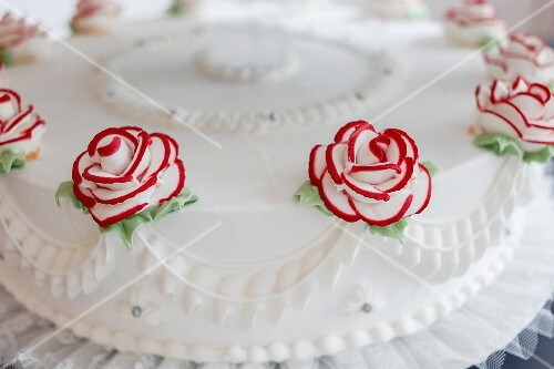A wedding cake with sugar roses