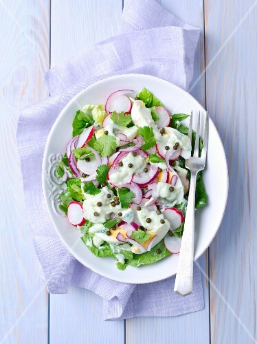 Cos lettuce with radishes, eggs, marinated peppers and an avocado-yoghurt sauce