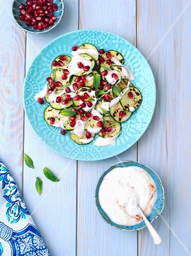 Grilled courgette with yoghurt, sambal oelek and pomegranate